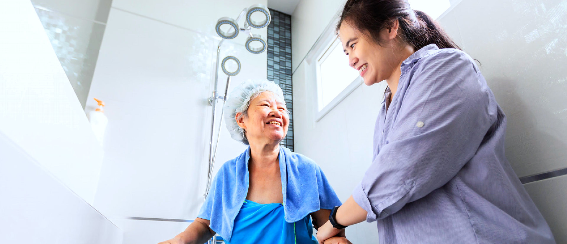 senior woman getting help from caregiver